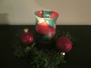 DIY Stained Glass Candle Holder - finished candle holder with candle lit, dark image
