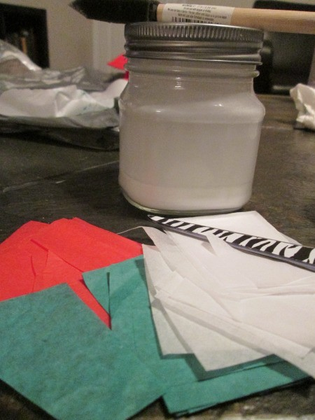 DIY Stained Glass Candle Holder - jar of glue mixture and cut up tissue paper in red, white, and green