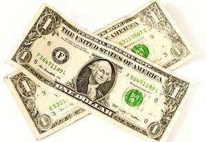 Two U.S. Dollar bills on a white background.