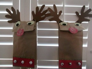 Reindeer Puppets - puppets against wooden blinds