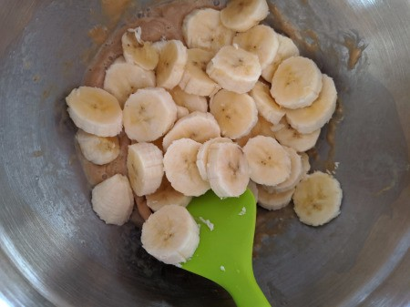 Banana added to cashew butter & egg in bowl