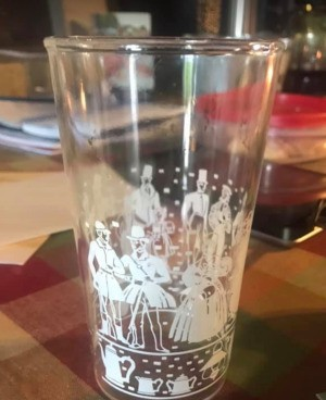 Identifying Drinking Glasses - clear glasses with white design of people in Victorian attire with a band of coffee pots and other images around the bottom