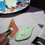 Painting the elf ears a light green.