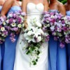 Bride and bridesmaids holding flowers.