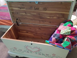 Value of a  Lane Aroma Tite Cedar Chest - white chest with heart and flower motif on the front