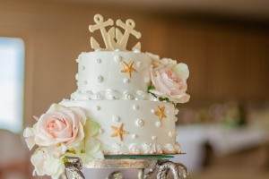 Wedding Cake with starfish on the sides and Anchors on top