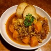 Spaghetti Squash Soup in bowl with bread