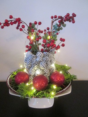Pine Cone Vase - white pine cone vase with fairy lights turned on