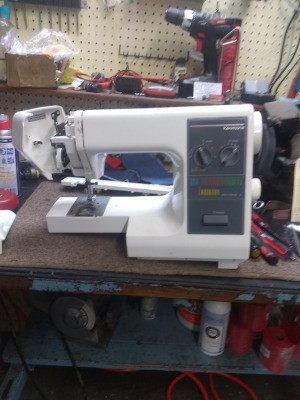 Removing the Front Cover on a Kenmore Sewing Machine  - sewing machine on a table