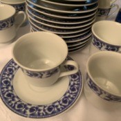 Value of Tea Cups and Saucers - white cups and saucers with blue trim pattern