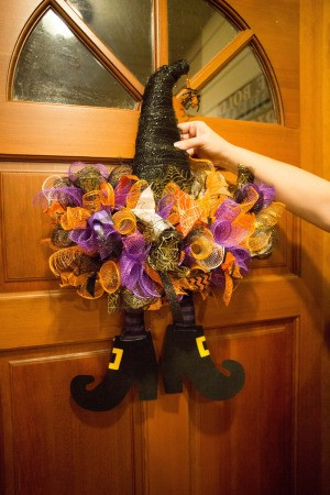 A decorated witch hat on a door.