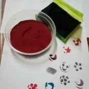 Making A Stamp Pad at Home -pad and paper with stamped images