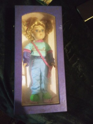 "Value of a Collector's Choice Porcelain Doll  - doll in original box, wearing a t-shirt with ""Smile"" on it"