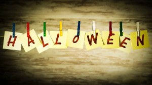 A Halloween banner made from paper and clothespins.
