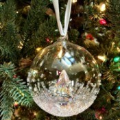 A clear glass ball ornament that has been decorated.