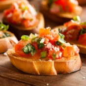 Small slices of bread topped with a tomato mixture.