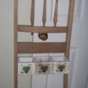 Recycled Chair Back as Decorative Rack/Planter - chair back with planters attached between legs, hanging on a doorknob