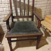Identifying Antique Chairs - old arm chair with decorative routing, and a leather(?) seat