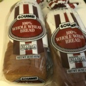 Loaves of bread with paper towels inside the bags.