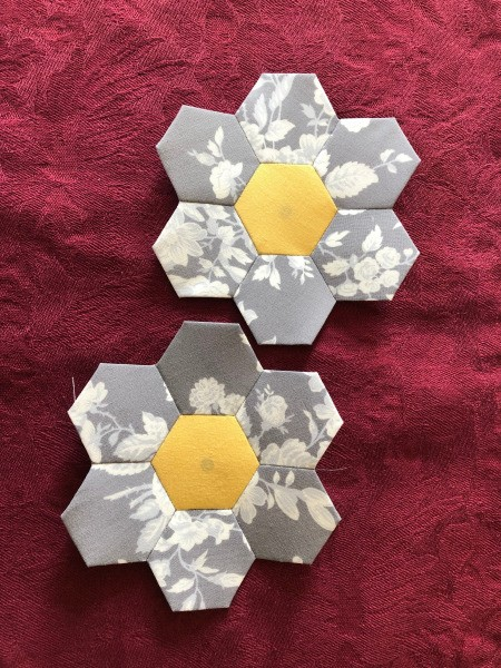 English Paper Pieced Flower Pillow - two sets of 6 hexagons around the yellow center