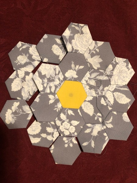 English Paper Pieced Flower Pillow - adding second round of gray and white floral