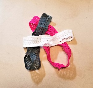 A collection of colored stretch headbands.