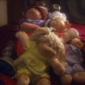 Value of Vintage Cabbage Patch Kids - pile of dolls