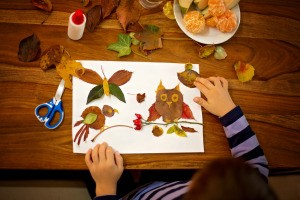 An owl craft made from fall leaves.