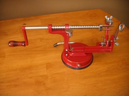 An apple peeler and corer.