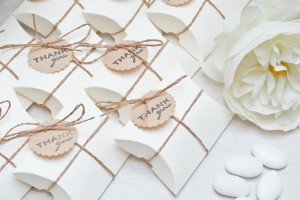 Wedding favors tied in twine.