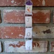 Snowman/Joy Paper Chain Ornament - hanging on the brick fireplace