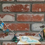 Christmas Tree Banner - banner on brick fireplace