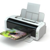A printer with a photo print in the tray.