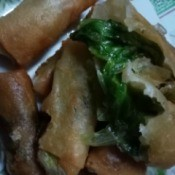cooked Leafy Cheese Rolls on plate
