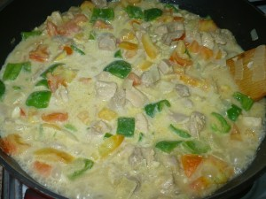 mixing Chicken Curry With Fresh Coconut Milk