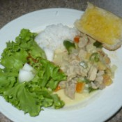 Chicken Curry With Fresh Coconut Milk and salad and rice on plate