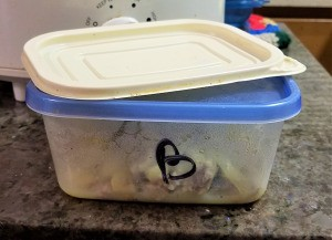 "A container with a blue lid that is marked with a ""B""."