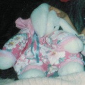 Identifying a Stuffed Bunny - white stuffed lop eared bunny wearing a dark pink floral outfit