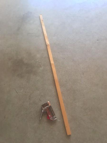 A long stick and a stapler.
