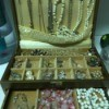 A jewelry box with a collection of different types of jewelry.