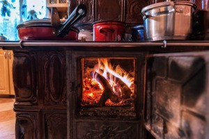 A wood burning stove in the kitchen.