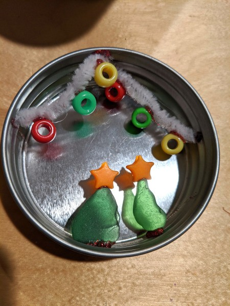 Mason Jar Lid Christmas Ornament - glue sea glass and star toppers in place