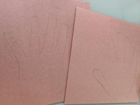 Reindeer Handprint Antler Hat - hands traced onto brown construction paper