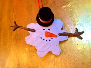 Melted Snowman Ornament - melted snowman ornament on light wood surface