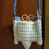 Crocheted Pouch with Lanyard for Crafting Supplies - pouch filled and hanging from lanyard
