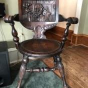 Identifying a Wooden Chair -carved back wooden chair with a round seat and turned legs