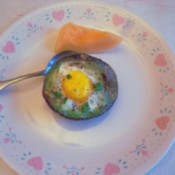 Baked Eggs in Avocado on plate