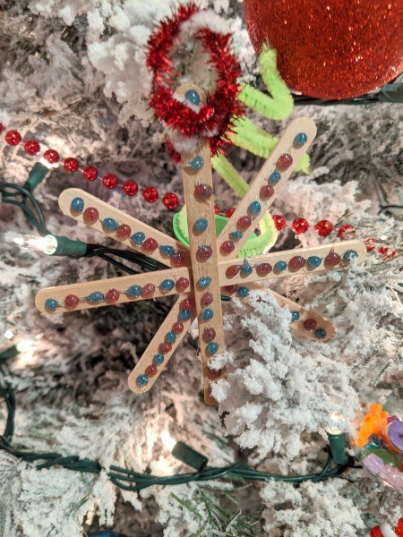 Making Popsicle Stick Snowflake Ornaments - ornament on the tree