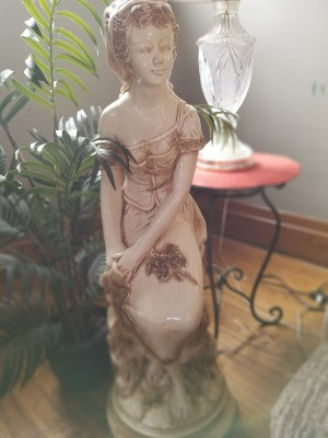 Identifying a Large Old Italian Statue - woman sitting