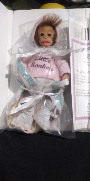 Age of an Ashton-Drake Monkey Doll - baby monkey doll in box